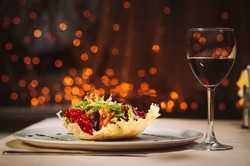 Glass of a red wine and salad