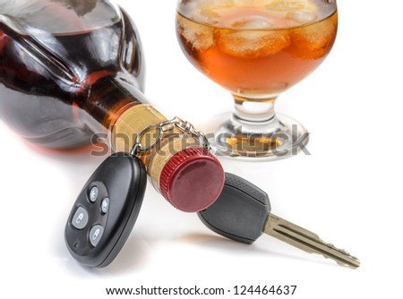 glass of alcohol and car keys. Photo isolated on white background