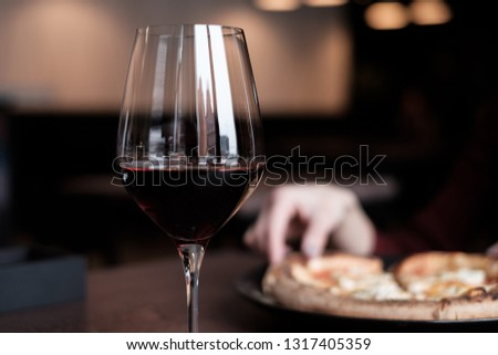 Glass of alcohol Free Merlot on dinner table #1317405359