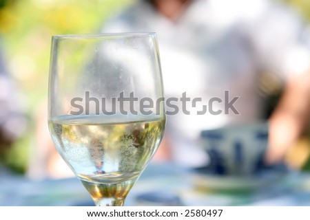 glass of alcohol outdoors in the summer garden