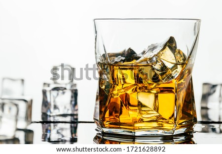 Glass of alcohol with ice cubes with white background ストックフォト ©