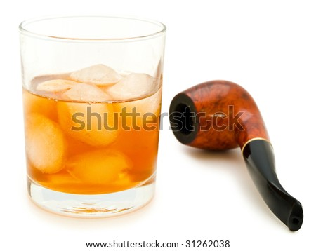 glass of alcoholic drink with ice cubes and tobacco pipe
