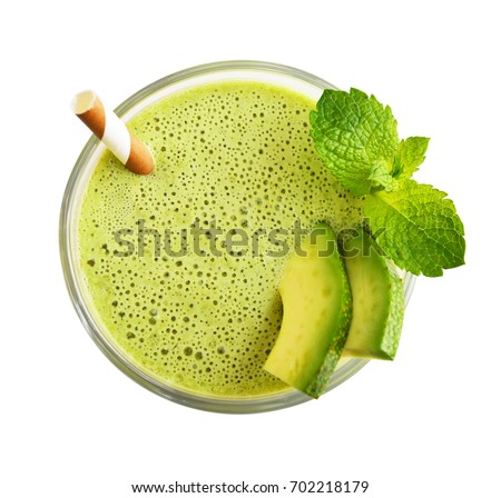 Glass of avocado smoothie with drinking straw and mint leaves  isolated on white background, top view #702218179