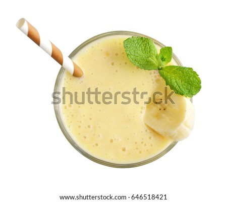 Glass of banana milkshake or smoothie with drinking straw and mint leaves  isolated on white background, top view