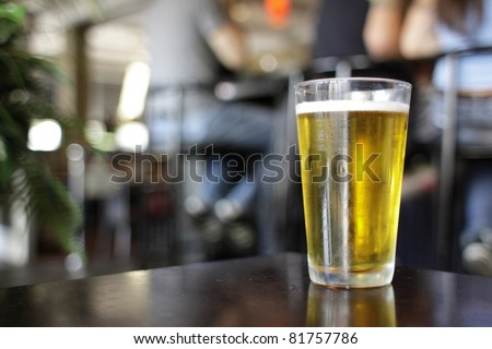 Glass of beer at a bar