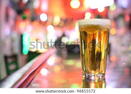 Glass of beer at a bar.