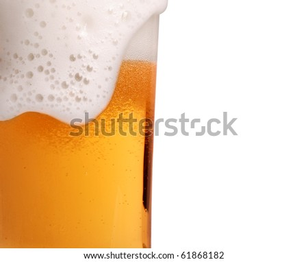 Glass of beer close-up with froth - stock photo