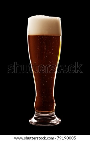 glass of beer isolated over a black background