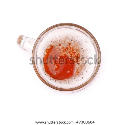 glass of beer on a white background, top view
