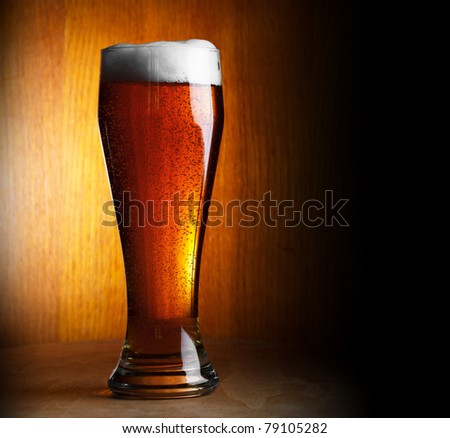 glass of beer on dark background with copy-space