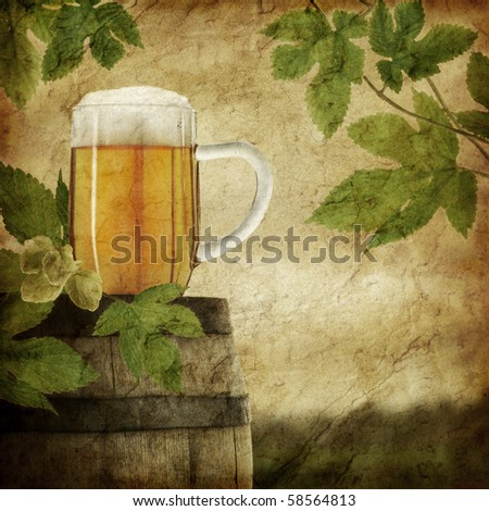 Glass of beer on old barrel and hop plant, grunge image
