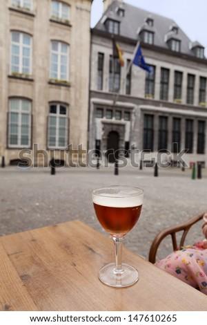 Glass of beer on table in street restaurant, Antwerpen, Belgium
