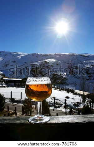 Glass of beer or lager on wall in the Sierra Nevada Ski resort on the Costa del Sol in southern Spain