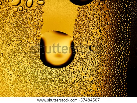 Glass of beer with dew bubbles. Background for design works.