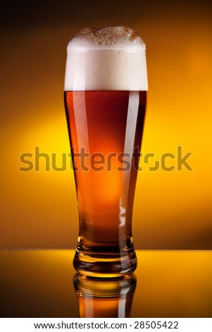 Glass of beer with froth, close-up