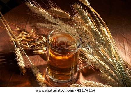 Glass of beer with grain - stock photo