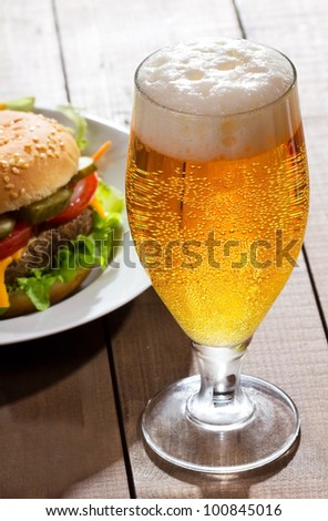 glass of beer with hamburger