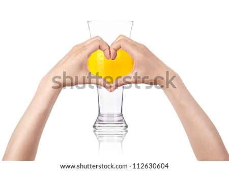 Glass of beer with the heart  made of two women hands. love beer concept