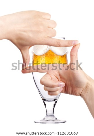 Glass of beer with two women hands making frame. love beer concept