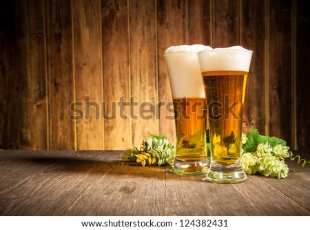 Glass of beers on wooden table