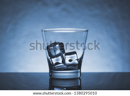 Glass of beverages with ice cube, reflection on black table. Background texture of cool beverage or refreshments water #1380295010
