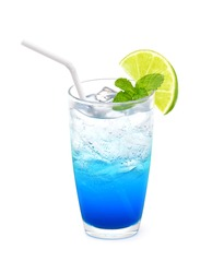 Glass of Blue Hawaii Italian soda with lime and mint leaf isolated on white background, Colorful summer beverage.