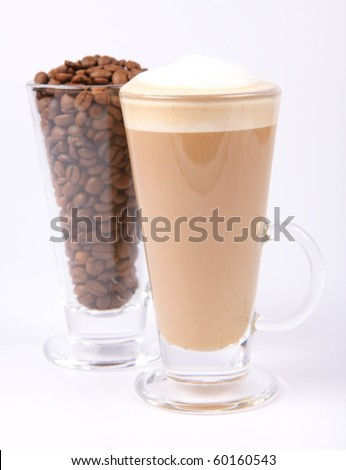 Glass of caffe latte with a glass of coffee beans on white background