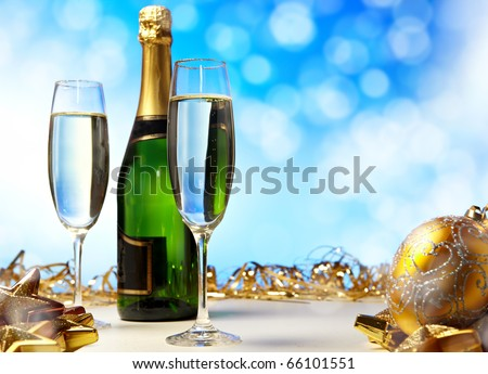 Glass of champagne against blue background