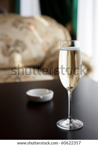 Glass of champagne on restaurant table