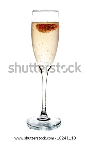 Glass of champagne with strawberry inside