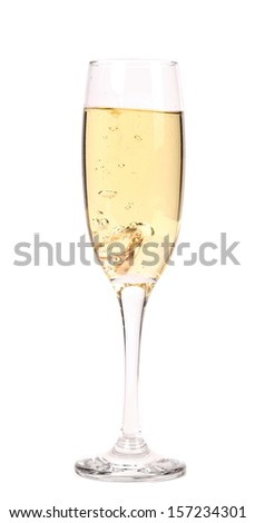 Glass of champagne with wedding rings. Close up