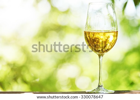 Glass of Chardonnay, Sauvignon or Rkatsiteli white wine over outdoors background  #330078647