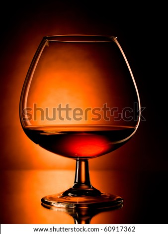 glass of cognac, dramatic light, vibrant colors