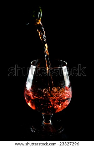 Glass of cognac on a black background