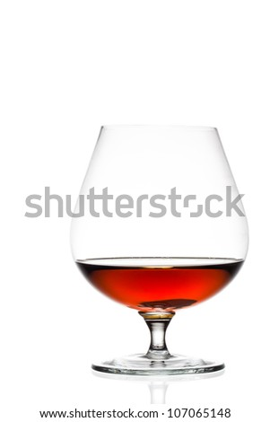glass of cognac or brandy isolated on white background