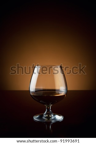 Glass of cognac with copy space