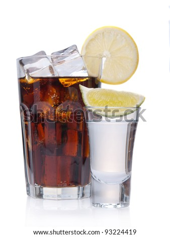 Glass of coke and a shot; isolated on white