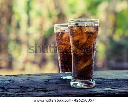 glass of cola with ice cubes,Drink Soda.