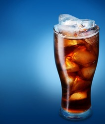 Glass of cola with ice on a blue background
