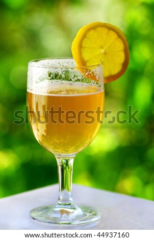 Glass of cold beer and lemon.