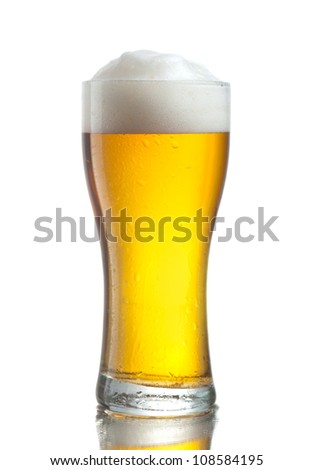 Glass of cold beer with froth and cool drops