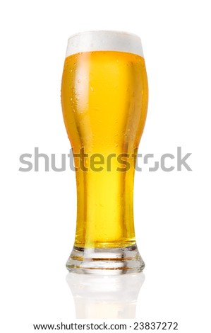 Glass of cold beer with water drops isolated on white background