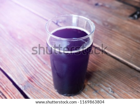 Glass of cold craft stout beer on the old table in old fashioned pub. #1169863804