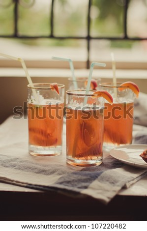 Glass of cold fresh tea with peach