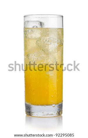 Glass of cold orange beverage with ice