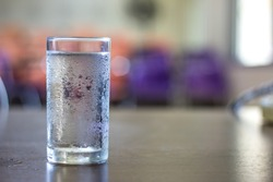 glass of cold water on desk in office