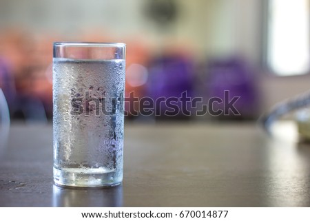 glass of cold water on desk in office #670014877