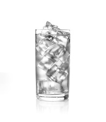 Glass of cold water with ice cubes.