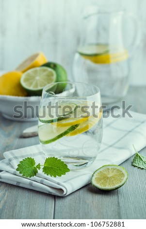 Glass of cold water with lemon and lime