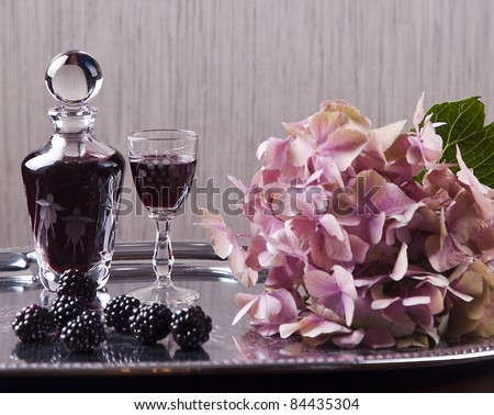 glass of cordial and hydrangea